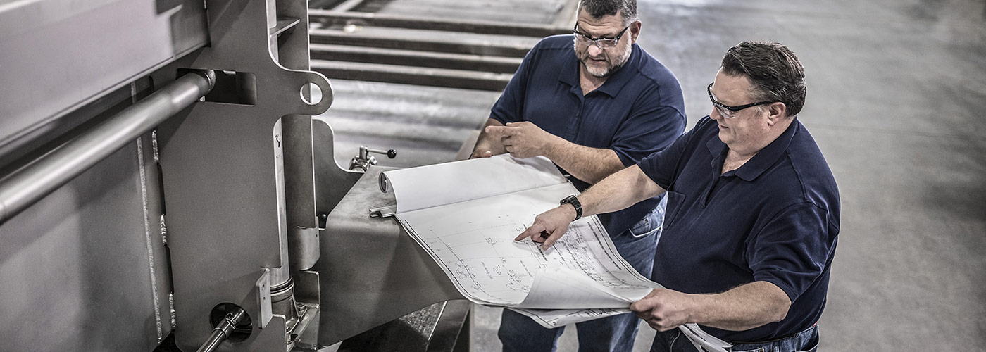 Project management overseeing manufacturing