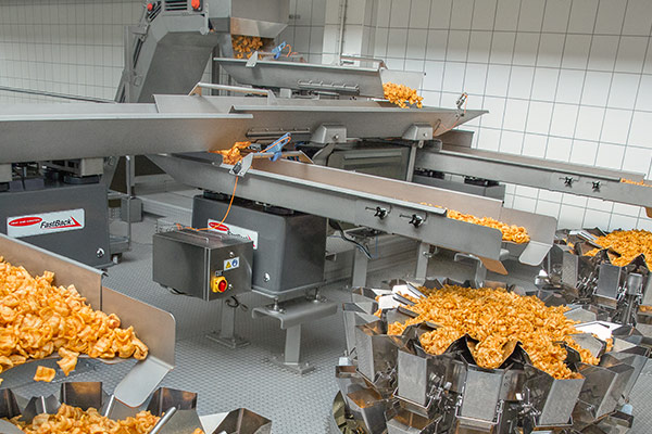Conveying snack food to packaging equipment
