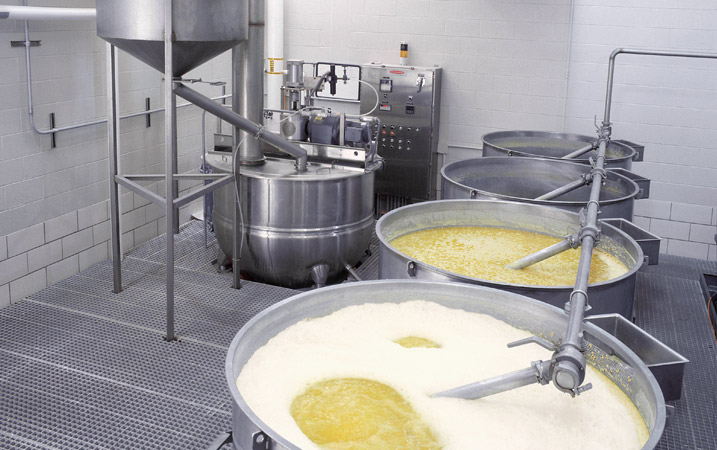 Corn cooking system with simmer and soak tanks