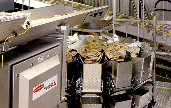 Conveying sausage patties to multihead weigher scales