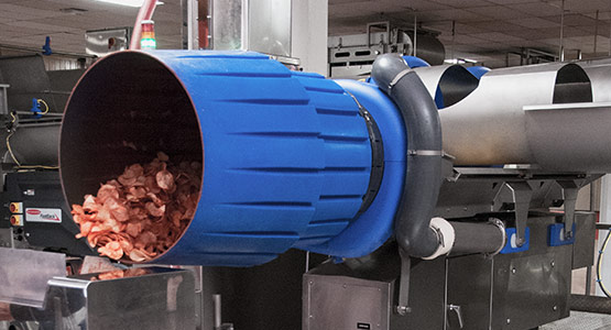 On-machine seasoning system for snack foods