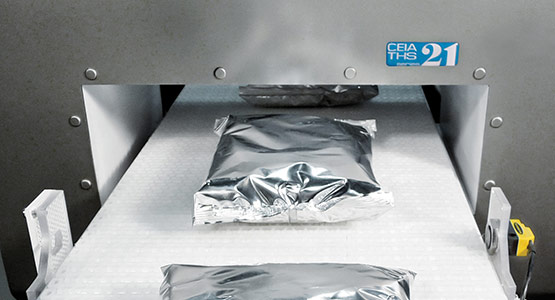 Industrial metal detection for products in foil or aluminum packaging