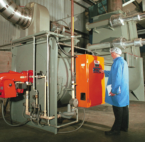 Man operating Heat and Control's KleenHeat Heat Exchanger