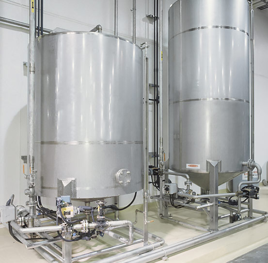Oil holding tanks for continuous and batch fryer systems