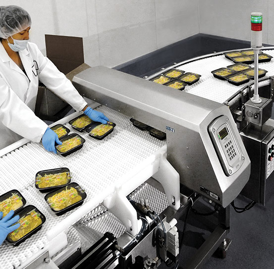 Industrial food metal detector inspecting ready meals