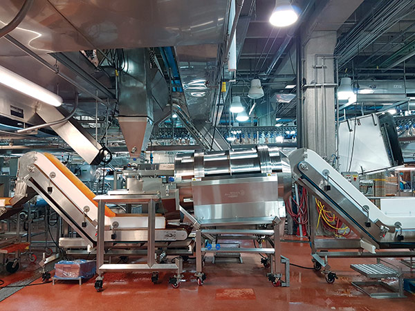 Spray Dynamics seasoning system for spiced poultry line