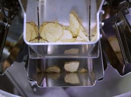 Automated weighing of snack foods and potato chips