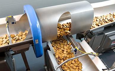 Conveying crackers to packaging equipment