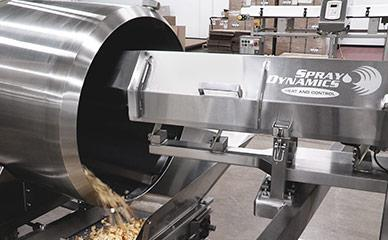 Spray Dynamics seasoning application for croutons