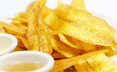 Frying systems for plantain and banana chips lines