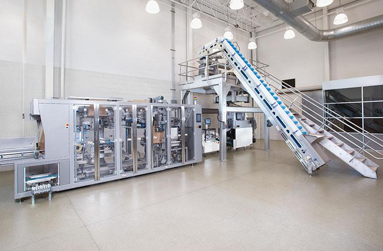 Snack packaging line from in-feed to case packing